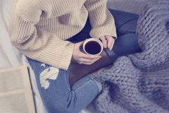 Young girl with a cup of coffee. Young girl with a book and a cup of coffee Stock Photos