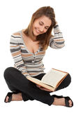 Young girl with book in the hand Royalty Free Stock Image