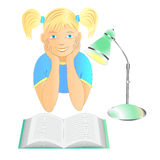 Young girl with a book and a reading lamp Stock Photo