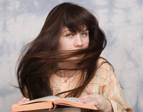 The young girl with books Royalty Free Stock Images