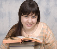 The young girl with books Stock Photos