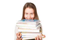 Young girl with books isolated over white Stock Photos