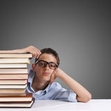 Young girl with books stacked Stock Photography