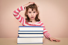 Young girl and books Stock Photos