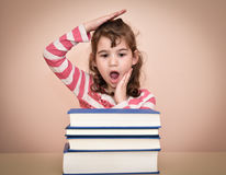 Young girl and books Royalty Free Stock Photo