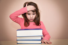 Young girl and books Royalty Free Stock Images