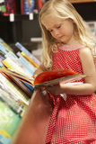 Young girl in bookshop Royalty Free Stock Images