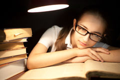 Young girl bored at reading Royalty Free Stock Photography