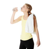 Young girl with bottle of mineral water Stock Photography