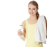 Young girl with bottle of mineral water Royalty Free Stock Photo