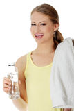 Young girl with bottle of mineral water Royalty Free Stock Photography
