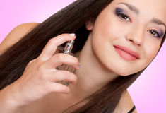 Young girl with a bottle of perfume Stock Image