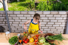 Young girl bottling fresh vegetables Royalty Free Stock Images