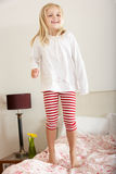 Young Girl Bouncing On Bed Royalty Free Stock Photo