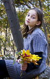 Young girl with a bouquet of  autumn leaves Stock Images
