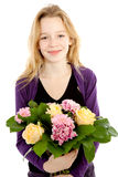 Young girl with bouquet of flowers Royalty Free Stock Photography