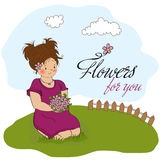 Young girl with a bouquet of flowers Stock Photos