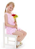 Young girl with a bouquet of flowers Stock Image