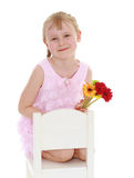 Young girl with a bouquet of flowers Royalty Free Stock Image