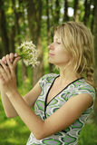 Young girl with a bouquet of flowers in nature Royalty Free Stock Photography