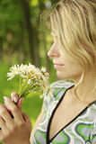 Young girl with a bouquet of flowers in nature Stock Image