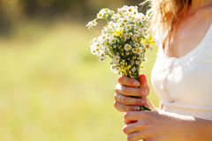 Young girl with a bouquet of flowers in nature Royalty Free Stock Images