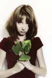 Young girl with bouquet of leaves Stock Photography