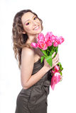 Young girl with a bouquet of pink tulips Royalty Free Stock Photography