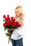 Young girl with a bouquet of roses. Beautiful young girl with a bouquet of roses Royalty Free Stock Photography