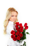 Young girl with a bouquet of roses Stock Photo