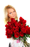 Young girl with a bouquet of roses Stock Image