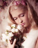 Young girl with bouquet from roses Stock Image