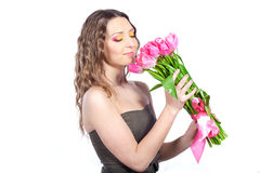 Young girl with a bouquet of tulips Stock Photos