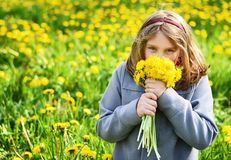 Young girl with bouquet of yellow flowers. Royalty Free Stock Image