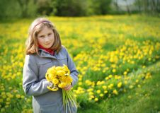 Young girl with bouquet of yellow flowers. Royalty Free Stock Images