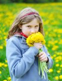 Young girl with bouquet of yellow flowers. Stock Photo