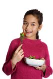 A young girl with a bowl of fresh salad Royalty Free Stock Photography