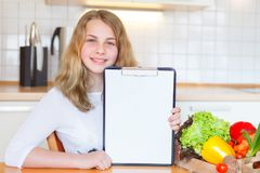 Young girl with a box full of vegetables stock photo