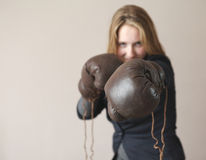 Young girl with boxing glove royalty free stock photo