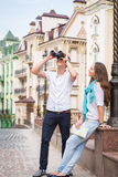 A young girl and boy of the beautiful city. Relax in the historic city. Joy and sincere feelings of young people. Professional makeup. Photos for magazines Stock Photography