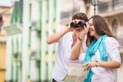 A young girl and boy of the beautiful city. Relax in the historic city. Joy and sincere feelings of young people. Professional makeup. Photos for magazines Royalty Free Stock Images