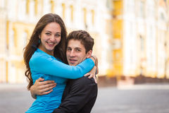 A young girl and boy of the beautiful city. Relax in the historic city. Joy and sincere feelings of young people. Professional makeup. Photos for magazines Royalty Free Stock Photography