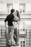 A young girl and boy of the beautiful city. Relax in the historic city. Joy and sincere feelings of young people. Professional makeup. Photos for magazines Stock Images