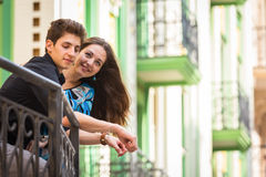 A young girl and boy of the beautiful city. Relax in the historic city. Joy and sincere feelings of young people. Professional makeup. Photos for magazines Royalty Free Stock Image