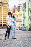 A young girl and boy of the beautiful city. Relax in the historic city. Joy and sincere feelings of young people. Professional makeup. Photos for magazines Stock Photos
