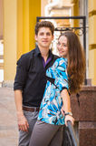 A young girl and boy of the beautiful city. Relax in the historic city. Joy and sincere feelings of young people. Professional makeup. Photos for magazines Royalty Free Stock Photos