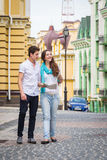 A young girl and boy of the beautiful city. Relax in the historic city. Joy and sincere feelings of young people. Professional makeup. Photos for magazines Stock Image