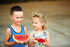 Young girl and boy eating watermelon Stock Photo