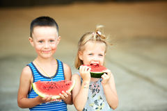 Young girl and boy eating watermelon Royalty Free Stock Photography