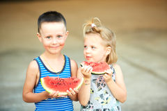 Young girl and boy eating watermelon Royalty Free Stock Photo